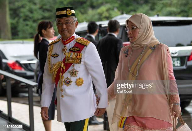 King Sultan Abdullah Sultan Ahmad Shah and Queen Tunku Azizah Aminah Maimunah of Malaysia arrive to attend the Enthronement Ceremony Of Emperor...