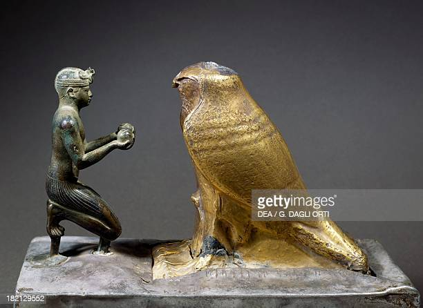 King Taharka offering wine to the FalconGod Hemen bronze and gold plated schist Egyptian Civilisation Third Intermediate Period Dynasty XXV Paris...