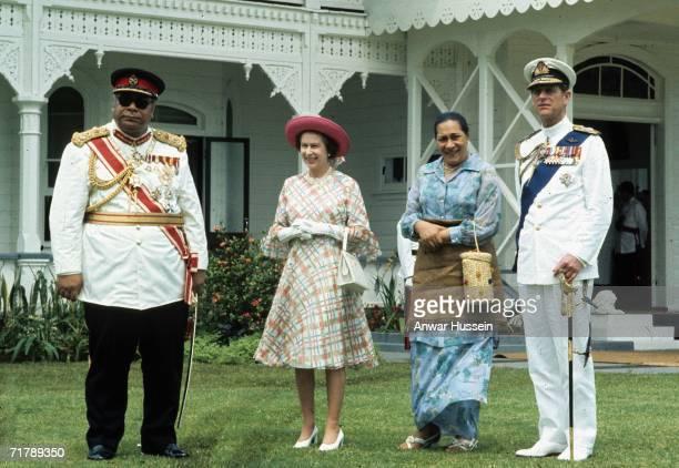 King Taufa'ahau Tupou lV of Tonga and his wife meet Queen Elizabeth ll and Prince Philip, Duke of Edinburgh, during their visit to Tonga in February...