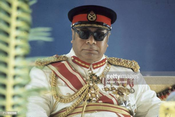 King Taufa'ahau Tupou lV of Tonga looks on during the visit of Queen Elizabeth ll and Prince Philip, Duke of Edinburgh to Tonga in February 1977.