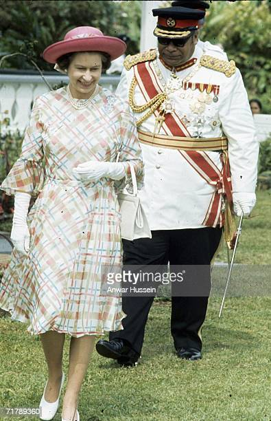 King Taufa'ahau Tupou lV of Tonga walks with Queen Elizabeth ll during her visit with Prince Philip, Duke of Edinburgh to Tonga in February 1977.