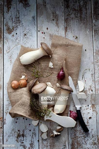 King trumpet mushrooms and knife on jute