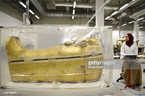 King Tutankhamun's sarcophagus is shown to the media near Cairo on Aug. 4 as the Egyptian Ministry of Antiquities carries out its first-ever...