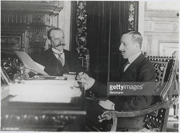 King Weighs Questions of State. His majesty Alphonso XIII of Spain seen at his desk in the days of the old regime.