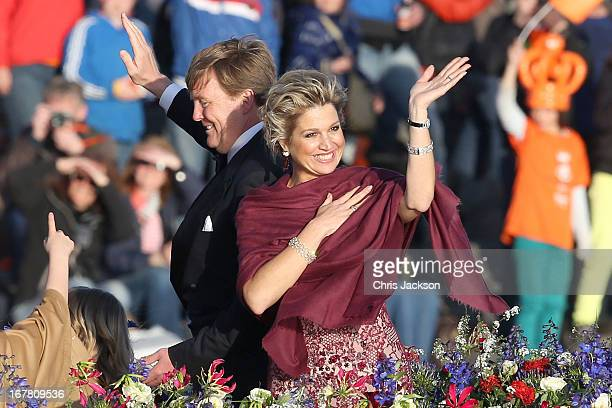 King Willem Alexander and Queen Maxima are seen aboard the King's boat for the water pageant to celebrate the inauguration of King Willem of the...
