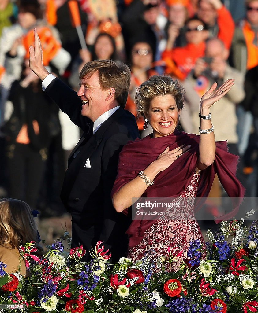 King Willem Alexander and Queen Maxima are seen aboard the King?s boat for the water pageant to celebrate the inauguration of King Willem of the Netherlands after the abdication of his mother Queen Beatrix of the Netherlands on April 30, 2013 in Amsterdam, Netherlands.