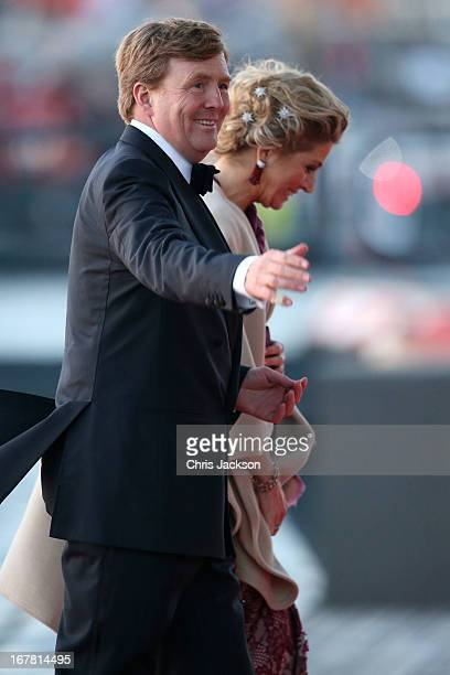 King Willem Alexander and Queen Maxima of The Netherlands arrive at the Muziekbouw following the water pageant after the abdication of Queen Beatrix...
