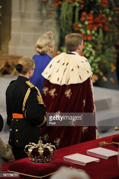 King Willem Alexander and Queen Maxima of the Netherlands leave after their inauguration ceremony at New Church on April 30 2013 in Amsterdam...
