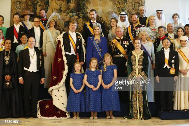 King Willem Alexander and Queen Maxima of the Netherlands pose with guests following their inauguration ceremony at the Royal Palace on April 30 2013...