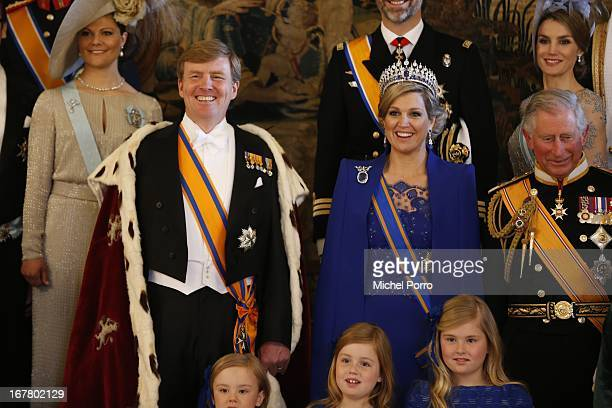 King Willem Alexander and Queen Maxima of the Netherlands pose with guests following their inauguration ceremony, at the Royal Palace on April 30,...