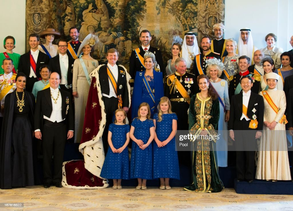 King Willem Alexander and Queen Maxima of the Netherlands pose with guests following their inauguration ceremony, at the Royal Palace on April 30, 2013 in Amsterdam, Netherlands.