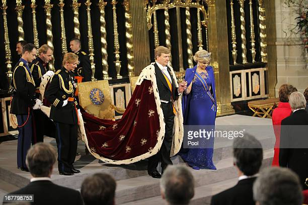 King Willem Alexander and Queen Maxima of the Netherlands prepare to leave after their inauguration ceremony at New Church on April 30, 2013 in...