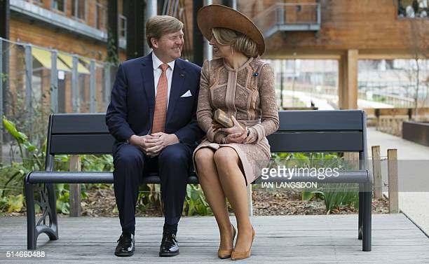 King Willem Alexander and Queen Maxima of the Netherlands sit on a bench which they gifted to a youth association during their visit the Halle Pajol...
