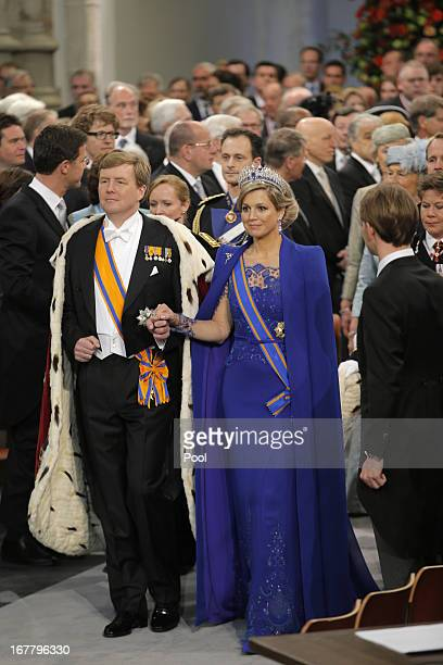 King Willem Alexander of the Netherlands and his wife HRH Queen Maxima of the Netherlands arrive to their inauguration ceremony at New Church on...
