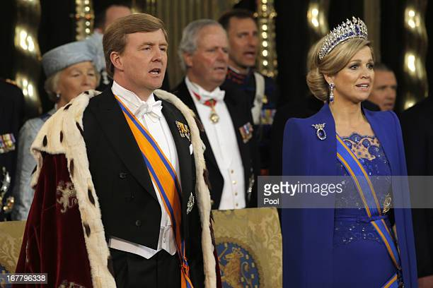 King Willem Alexander of the Netherlands and his wife HRH Queen Maxima of the Netherlands stand with members of the royal household on during their...