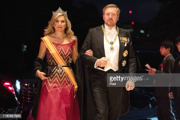 King Willem Alexander of the Netherlands and his wife Queen Maxima of the Netherlands arrive at the Imperial Palace for the Court Banquets after the...