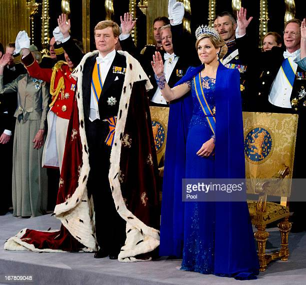 King Willem Alexander of the Netherlands and HM Queen Maxima of the Netherlands during their inauguration ceremony at New Church on April 30, 2013 in...