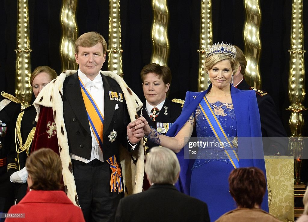King Willem Alexander of the Netherlands and Queen Maxima of the Netherlands (R)stand in front of members of the States General and the States of Aruba, Curacao and St Maarten as they swear an oath during the swearing in and investiture ceremony of King Willem Alexander of the Netherlands in front of the two houses of the States General in the Nieuwe Kerk on April 30, 2013 in Amsterdam, Netherlands.