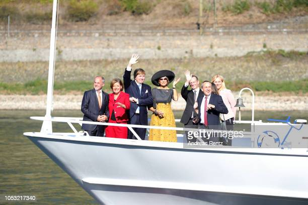 King Willem Alexander of The Netherlands and Queen Maxima of The Netherlands wave to the crowds upon her arrival for a boat trip on the river Rhine...