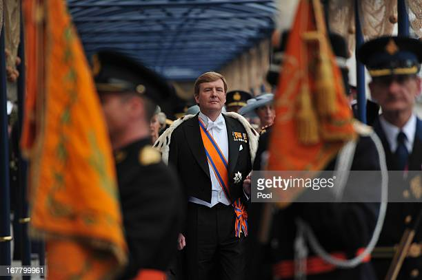 King Willem Alexander of the Netherlands leaves following the inauguration ceremony at New Church on April 30 2013 in Amsterdam Netherlands