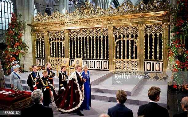 King Willem Alexander of the Netherlands leaves with HM Queen Maxima of the Netherlands after their inauguration ceremony at New Church on April 30...