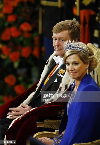 King Willem Alexander of the Netherlands sits alongside Queen Maxima of the Netherlands during his inauguration in front of a joint session of the...