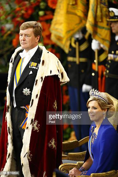 King Willem Alexander of the Netherlands stands alongside Queen Maxima of the Netherlands during his inauguration in front of a joint session of the...