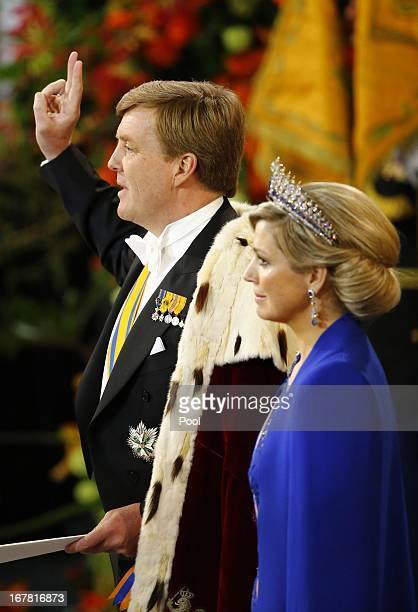 King Willem Alexander of the Netherlands takes an oath as he stands alongside Queen Maxima of the Netherlands during his inauguration in front of a...