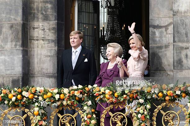King Willem Alexander Princess Beatrix of the Netherlands and Queen Maxima appear on the balcony of the Royal Palace to greet the public after her...