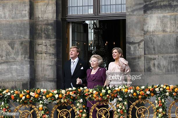 King Willem Alexander Princess Beatrix of the Netherlands and Queen Maxima sing with the audience on the balcony of the Royal Palace to greet the...