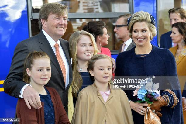 King Willem Alexander Queen Maxima and their daughters Amalia Ariane and Alexia pose in Tilburg on April 27 2017 as they arrive to celebrate the...