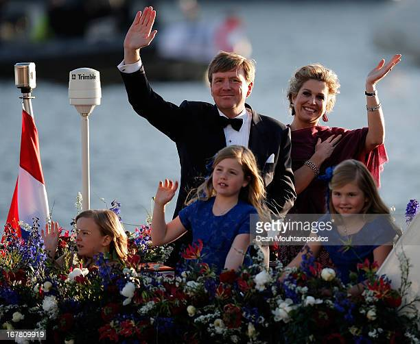 King Willem Alexander, Queen Maxima and their daughters Princess Catharina Amalia, Princess Ariane and Princess Alexia of the Netherlands wave to the...