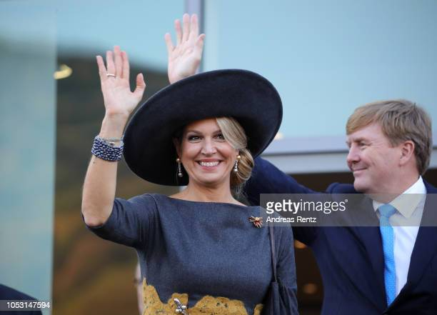 King Willem of The Netherlands and Queen Maxima of The Netherlands wave to the crowds on their departure on October 10 2018 in BernkastelKues Germany...