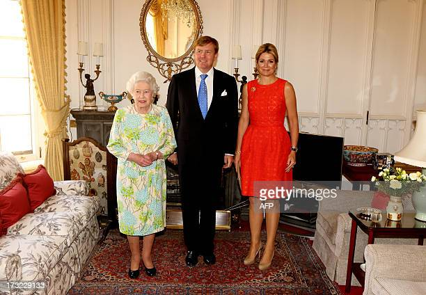 King WillemAlexander and his wife Queen Maxima of the Netherlands pose with Britain's Queen Elizabeth II on July 10 2013 at Windsor Castle AFP PHOTO...