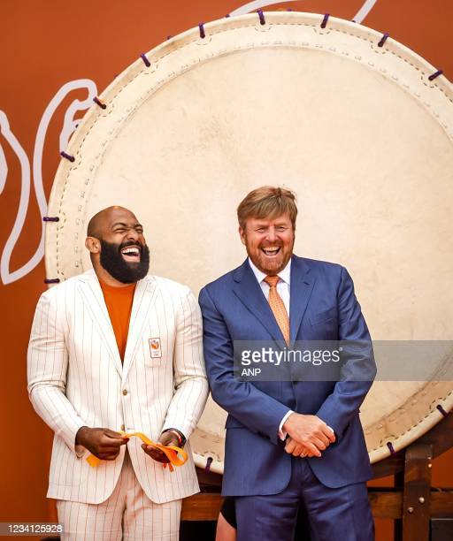 King Willem-Alexander and judoka Roy Meyer during the opening of TeamNL Olympic Festival on the sports beach of The Hague. The three-week festival is...