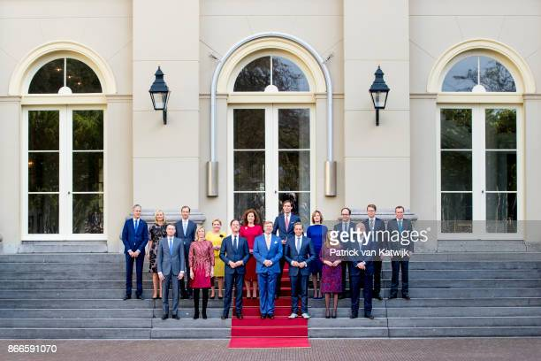 King WillemAlexander and Prime Minister Mark Rutte present the new cabinet on the stairs of Palace Noordeinde on October 24 2017 in The Hague...