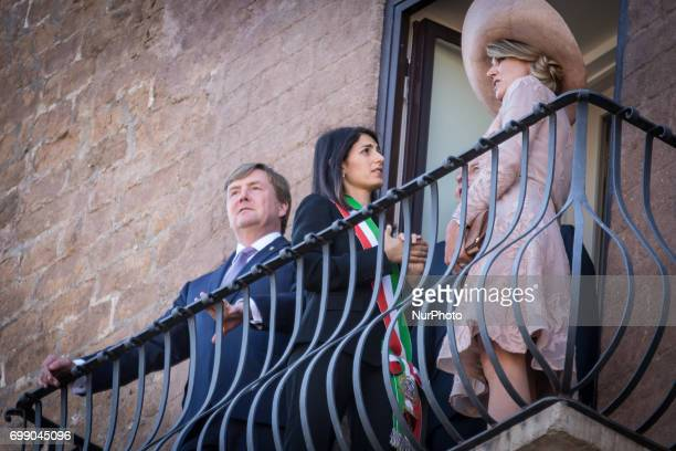 King Willem-Alexander and Queen Maxima of Netherlands stand on the balcony at Rome City Hall during a visit with Rome's mayor Virginia Raggi on June...
