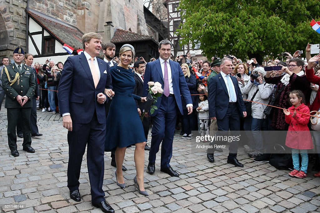 King Willem-Alexander and Queen Maxima of the Netherlands and Bavarian Minister of Ecnomic Affairs Markus Soeder are greeted by a large crowd after their visit of Albrecht Duerer's House on April 14, 2016 in Nuremberg, Germany. King Willem-Alexander and Queen Maxima are on a two-day visit in Bavaria to strengthen the relationship between Bavaria and the Netherlands.