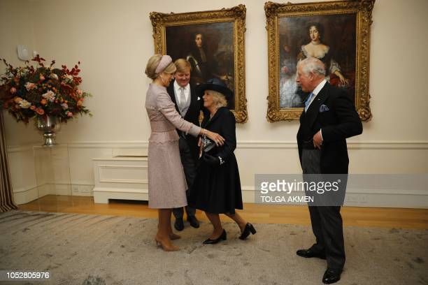 King WillemAlexander and Queen Maxima of the Netherlands are greeted by Britain's Prince Charles Prince of Wales and Britain's Camilla Duchess of...