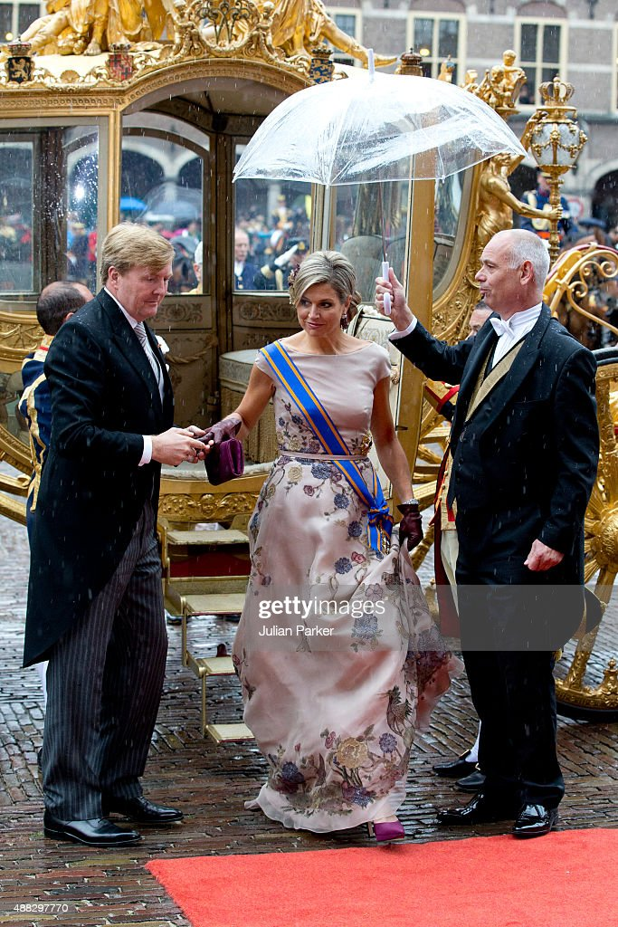 King Willem-Alexander (L), and Queen Maxima of The Netherlands arrive in The Golden Carriage for Prinsjesdag (Prince's Day) at The Binnenhof on September 15, 2015 in The Hague, Netherlands.