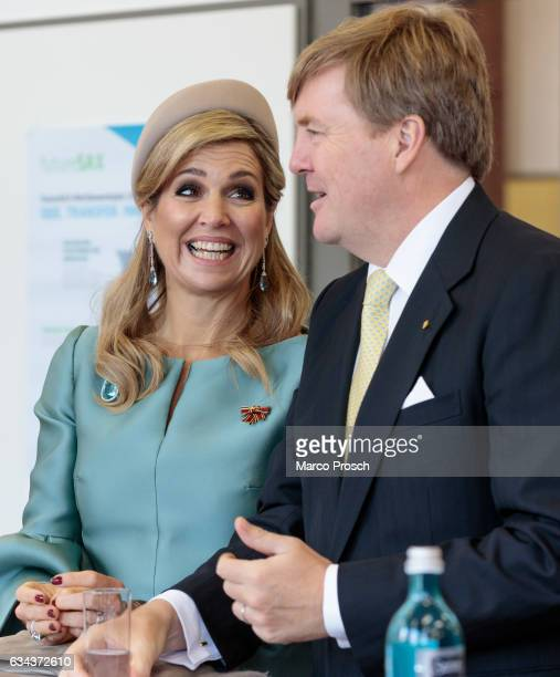 King WillemAlexander And Queen Maxima Of The Netherlands chat during a visit to the Spinlab a former cotton spinning mill now home to a startup...