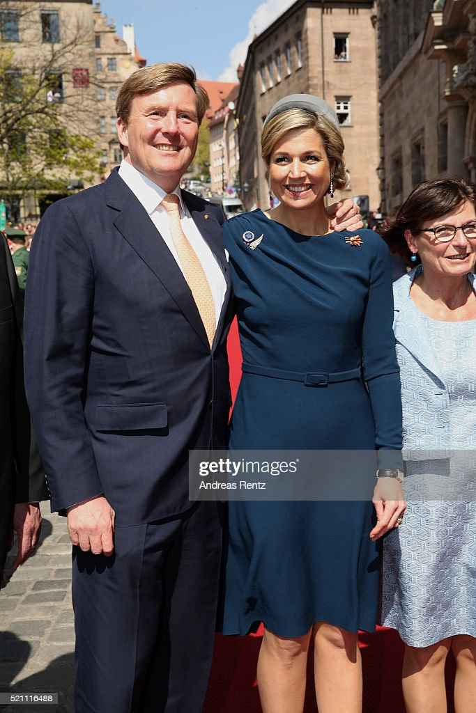 King Willem-Alexander and Queen Maxima of the Netherlands cross the Townhall square on April 14, 2016 in Nuremberg, Germany. King Willem-Alexander and Queen Maxima are on a two-day visit in Bavaria to strengthen the relationship between Bavaria and the Netherlands.