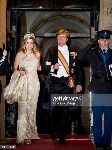 King Willem-Alexander and Queen Maxima of The Netherlands leave after the gala dinner for the Corps Diplomatic at the Royal Palace on May 23, 2017 in...
