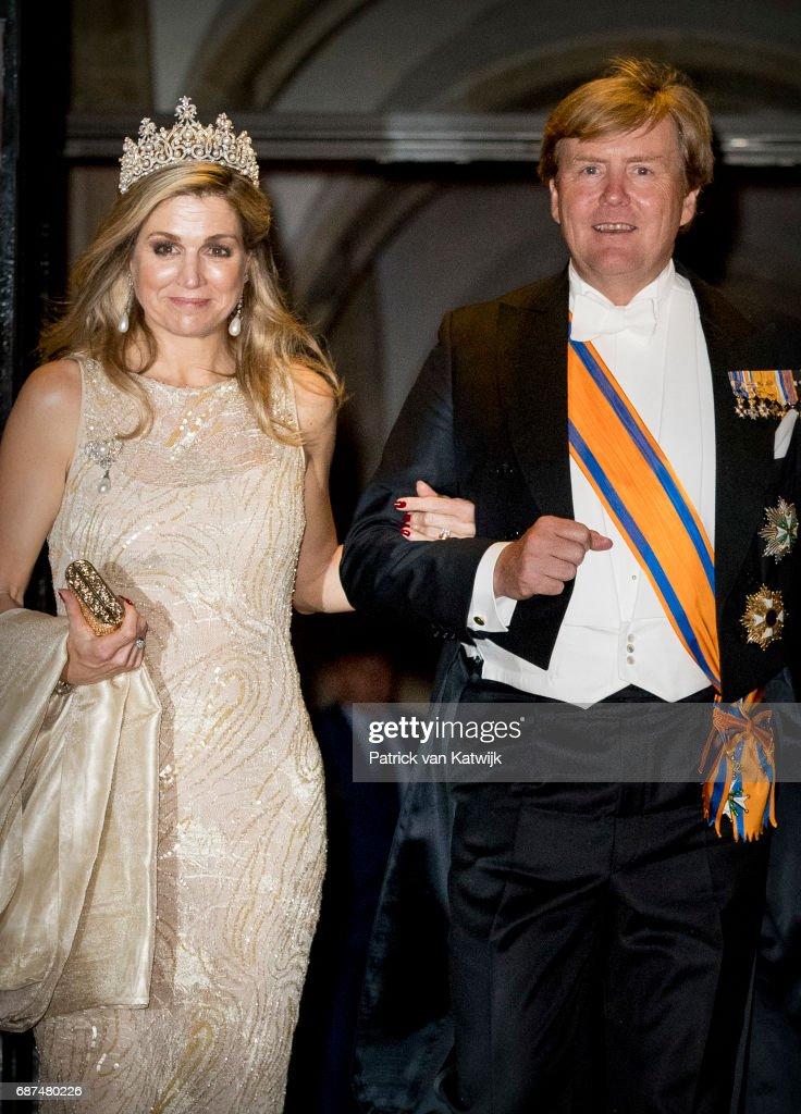 King Willem-Alexander and Queen Maxima of The Netherlands leave after the gala dinner for the Corps Diplomatic at the Royal Palace on May 23, 2017 in Amsterdam, Netherlands.