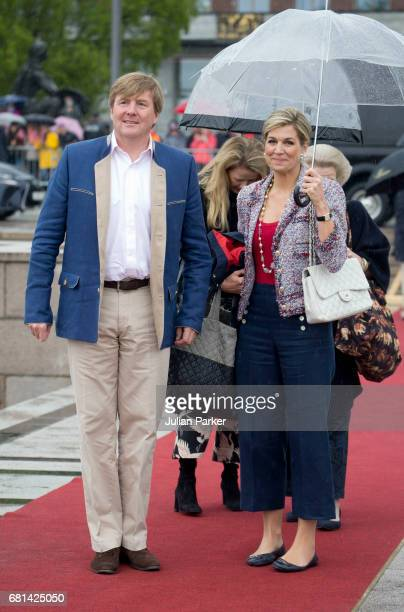 King WillemAlexander and Queen Maxima of The Netherlands leave to attend a lunch on the Norwegian Royal Yacht 'Norge' as part of the celebrations of...