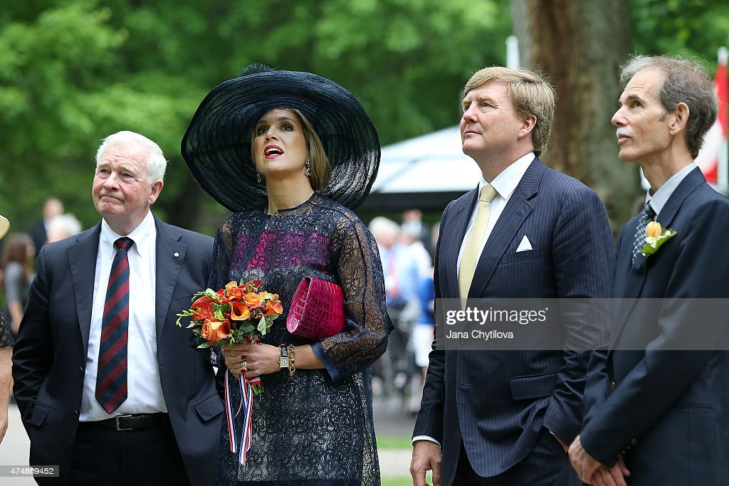 King Willem-Alexander and Queen Maxima of The Netherlands look at a tree on the Rideau Hall grounds during a during a state visit to Canada, on May 27, 2015 in Ottawa, Ontario, Canada.