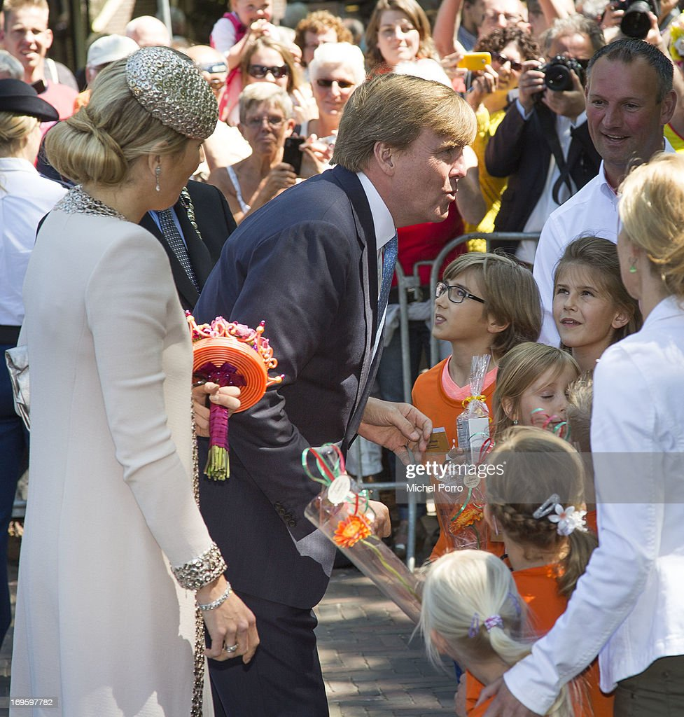 King Willem-Alexander and Queen Maxima of The Netherlands participate in activities during a one day visit to Groningen and Drenthe provinces at downtown Dwingelo on May 28, 2013 in Dwingelo, Netherlands.