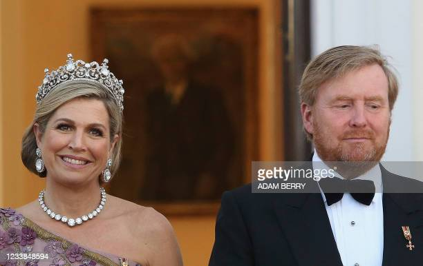 King Willem-Alexander and Queen Maxima of the Netherlands poses as they arrive for a state dinner in their honour at the Bellevue presidential palace...