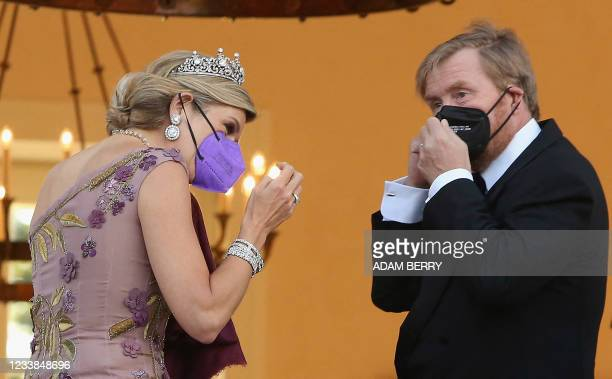 King Willem-Alexander and Queen Maxima of the Netherlands put on their face masks after posing ahead of a state dinner in their honour at the...