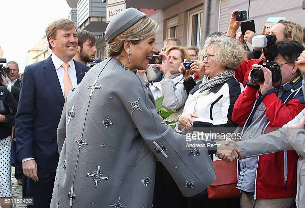 King WillemAlexander and Queen Maxima of the Netherlands shake hands with visitors upon their arrivat at Tucherschloss on April 14 2016 in Nuremberg...